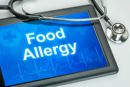 hypersensitivity: Tablet with the diagnosis food allergy on the display