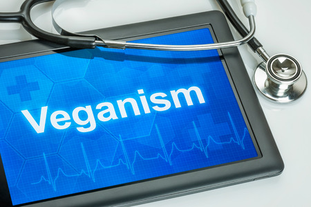 veganism: Tablet with the word Veganism on the display Stock Photo