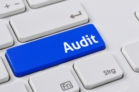 audit: A keyboard with a blue button - Audit Stock Photo
