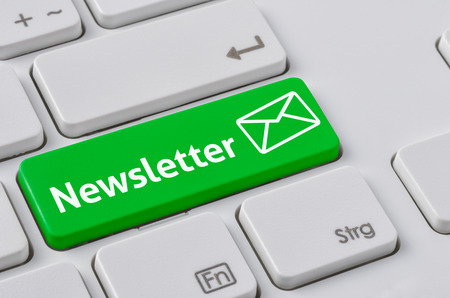 A keyboard with a green button - Newsletter 스톡 콘텐츠