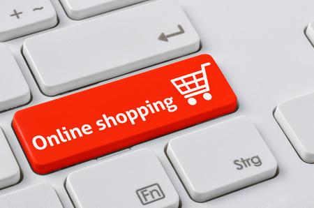 Un clavier avec un bouton rouge - Achats en ligne Banque d'images