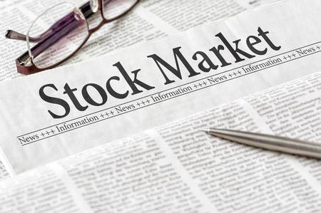 headline: A newspaper with the headline Stock Market Stock Photo