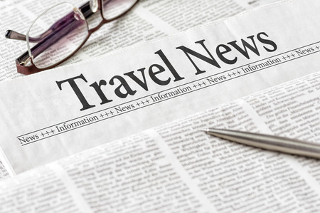 A newspaper with the headline Travel News