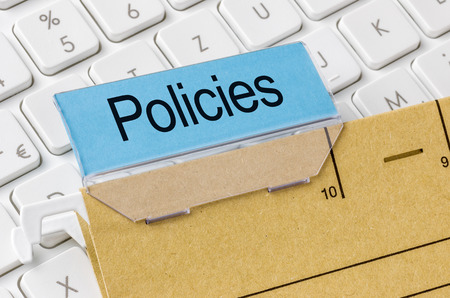 A brown file folder labeled with Policies photo