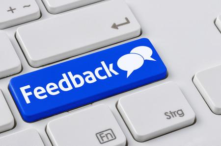 e survey: A keyboard with a blue button - Feedback