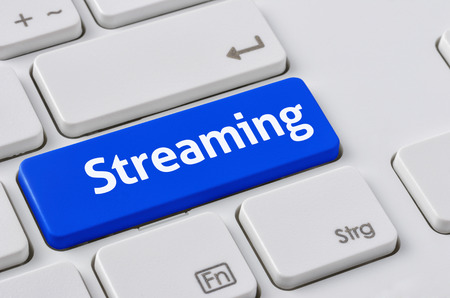 streaming: A keyboard with a blue button - Streaming Stock Photo