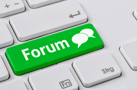 forums: A keyboard with a green button - Forum