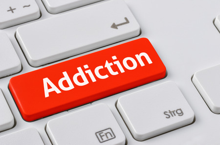substance abuse: A keyboard with a red button - Addiction