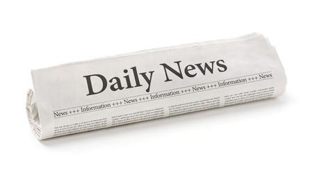 Gerollte Zeitung mit der Schlagzeile Daily News Standard-Bild