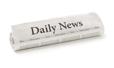 daily newspaper: Rolled newspaper with the headline Daily News