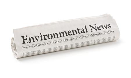 headline: Rolled newspaper with the headline Environmental News
