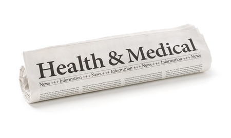 Rolled newspaper with the headline Health and Medical Stok Fotoğraf