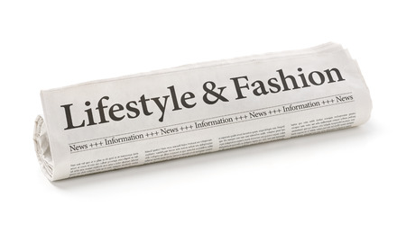 the latest models: Rolled newspaper with the headline Lifestyle and Fashion Stock Photo
