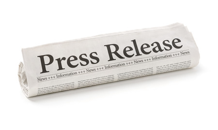 press release: Rolled newspaper with the headline Press Release