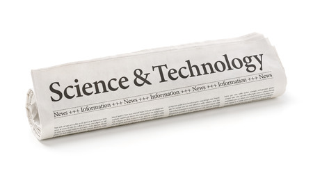 journals: Rolled newspaper with the headline Science and Technology Stock Photo