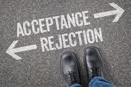 acceptance: Decision at a crossroad - Acceptance or Rejection Stock Photo