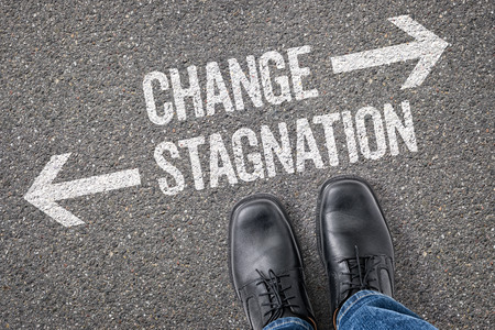 stagnation: Decision at a crossroad - Change or Stagnation Stock Photo