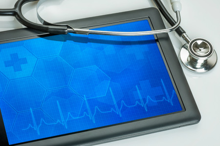 layout template: Tablet pc with stethoscope Stock Photo