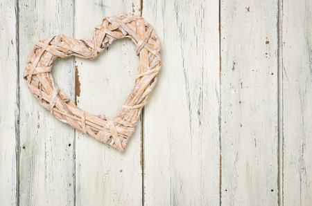 Braided heart on a white wooden background Stock Photo