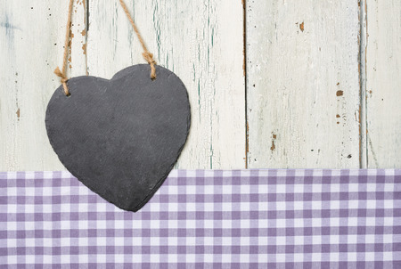patina: Empty heart-shaped sign on a white wooden background