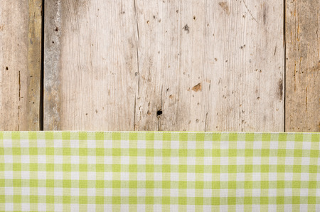 menue: Green checkered tablecloth on a rustic wooden background Stock Photo