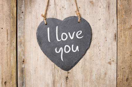 Heart-shaped slate sign with the inscription I love you Imagens