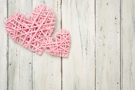 Pink hearts on a white wooden background