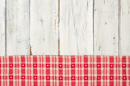 menue: Red checkered tablecloth with hearts on a white wooden background Stock Photo