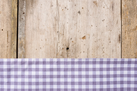 menue: Violet checkered tablecloth on a rustic wooden background Stock Photo