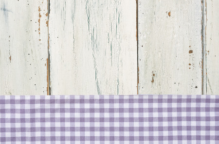menue: Violet checkered tablecloth on a white wooden background Stock Photo