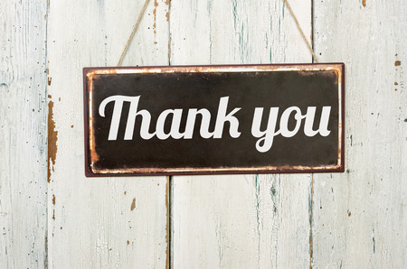 gratitude: Old metal sign in front of a white wooden wall - Thank you