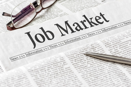 classified ad: A newspaper with the headline Job Market