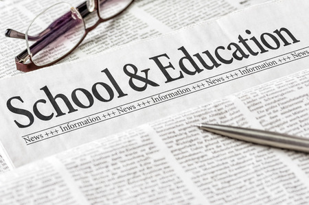 A newspaper with the headline School and Education photo