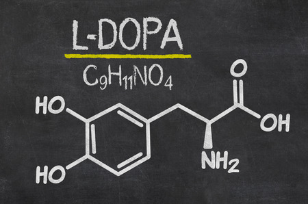 substances: Blackboard with the chemical formula of  L-DOPA