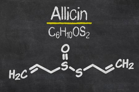 antiviral: Blackboard with the chemical formula of Allicin