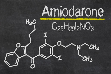 Blackboard with the chemical formula of Amiodarone Stock Photo