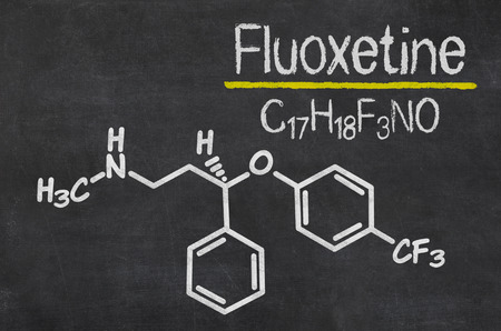 major depression: Blackboard with the chemical formula of Fluoxetine
