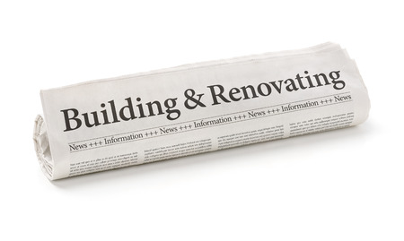 latest: Rolled newspaper with the headline Building and Renovating