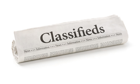classifieds: Rolled newspaper with the headline Classifieds