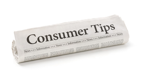 Rolled newspaper with the headline Consumer Tips photo