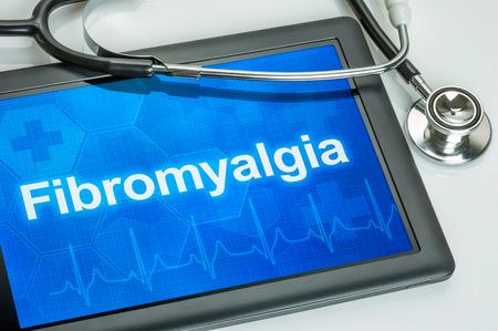 Tablet s diagnózou fibromyalgie na displeji Reklamní fotografie