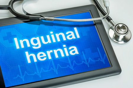 hernia: Tablet with the diagnosis Inguinal hernia on the display Stock Photo