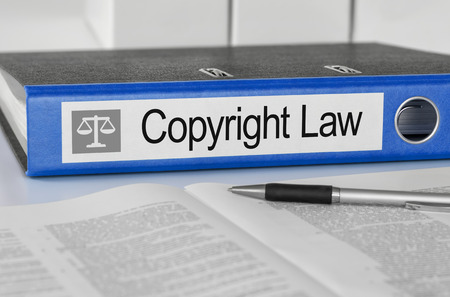 Blue folder with the label Copyright Law photo