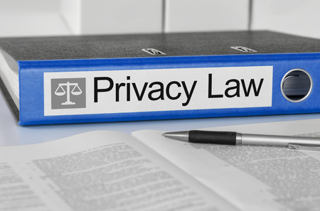 security laws: Blue folder with the label Privacy Law