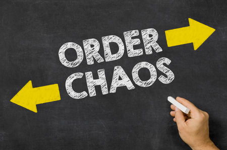 chaos order: Order or Chaos written on a blackboard