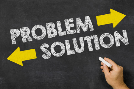 hands solution: Problem or Solution written on a blackboard Stock Photo