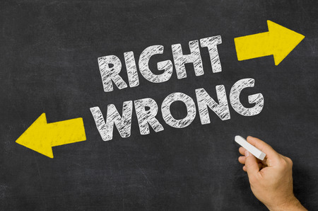 Right or Wrong written on a blackboard photo