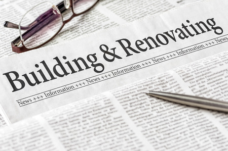newspaper headline: A newspaper with the headline Building and Renovating