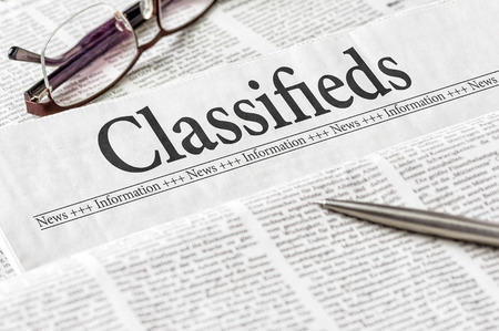 daily newspaper: A newspaper with the headline Classifieds