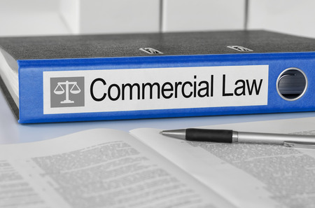 Blue folder with the label Commercial Law Stock Photo